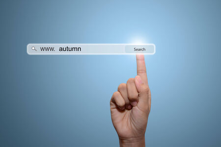 Business man hand pointing autumn Stock Photo