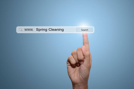 spring cleaning: Business man hand pointing Spring Cleaning