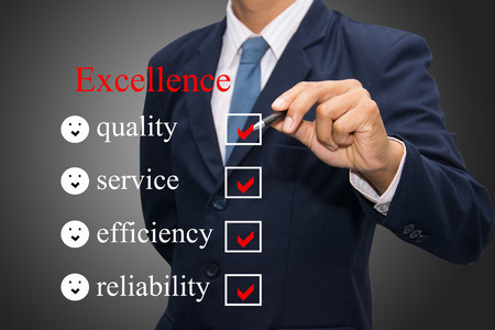 customer survey: Businessman Writing excellence concept.