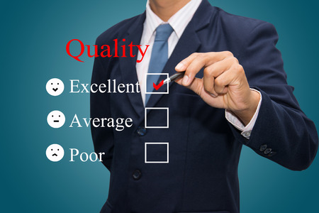 Business man Writing quality concept.
