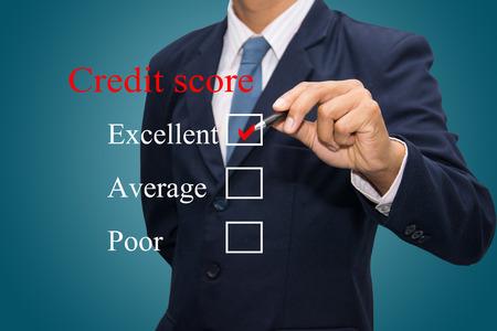 credit risk: Businessman Writing credit score concept.  Stock Photo