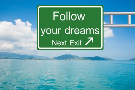 Creative Follow your dreams Road Sign  Standard-Bild