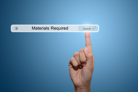 Business and technology, searching system and internet concept - male hand pressing Search Materials Required button.
