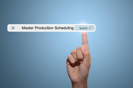 Business and technology, searching system and internet concept - male hand pressing Search Master Production Scheduling button.