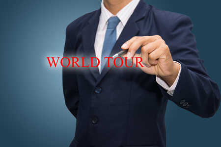 business man writing WORLD TOUR  photo