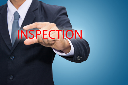 scrutinise: Businessman hand and INSPECTION