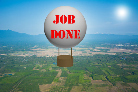 Write a JOB DONE on the balloon. photo