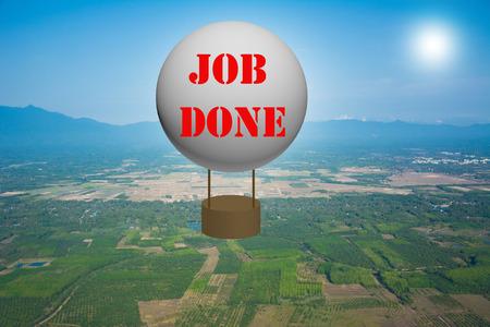 faultless: Write a JOB DONE on the balloon. Stock Photo