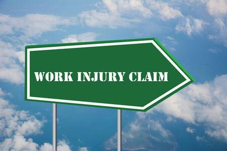 Write a WORK INJURY CLAIM on the Road Sign Standard-Bild