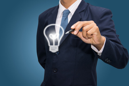business man writing idea Light bulb  photo