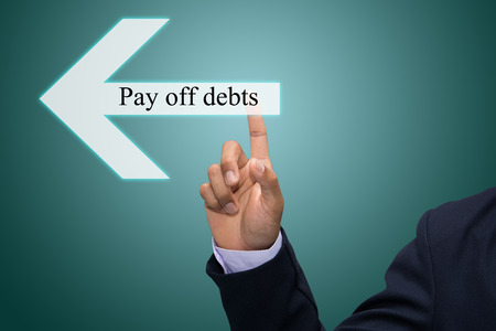 pay off: Business man hand pointing Pay off debts