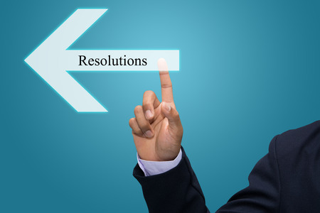 Business man hand pointing Resolutions photo