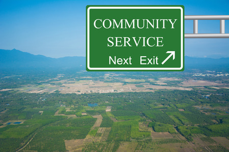 community service: Creative COMMUNITY SERVICE Road Sign concept. Stock Photo
