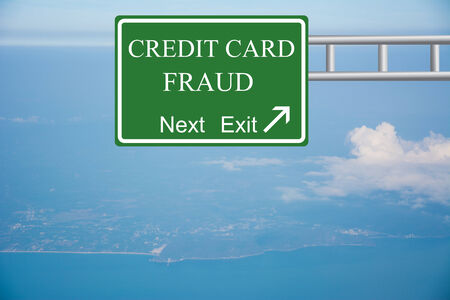 fraudulent: Creative CREDIT CARD FRAUD Road Sign concept. Stock Photo