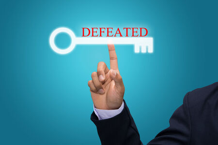 defeated: Business and technology, searching system and internet concept - male hand pressing DEFEATED Stock Photo