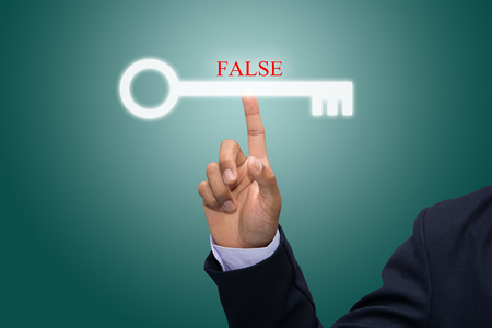 untrue: Business and technology, searching system and internet concept - male hand pressing FALSE