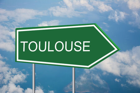 toulouse: Write a Toulouse on the Road Sign Stock Photo
