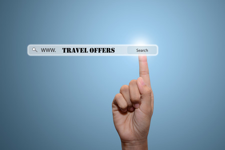breaks: Business and technology, searching system and internet concept - male hand pressing Search TRAVEL OFFERS button.
