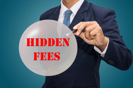 fees: business man writing HIDDEN FEES concept