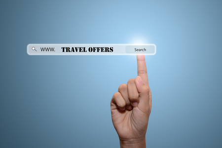 miles: Business and technology, searching system and internet concept - male hand pressing Search TRAVEL OFFERS button.