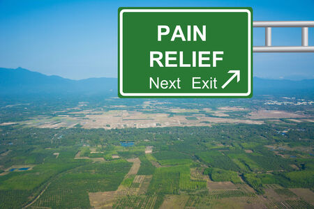 Creative PAIN RELIEF Road Sign concept. Stock Photo