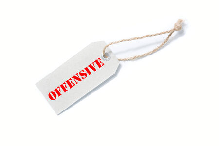 repulsive: business man writing OFFENSIVE concept Stock Photo