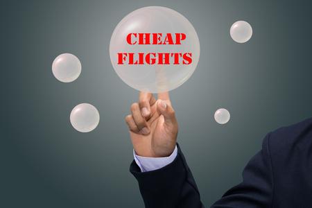 cheap: business man writing CHEAP FLIGHTS