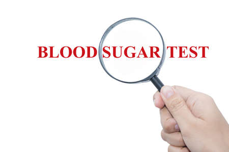 type 1 diabetes: Hand Showing BLOOD SUGAR TEST Word Through Magnifying Glass Stock Photo