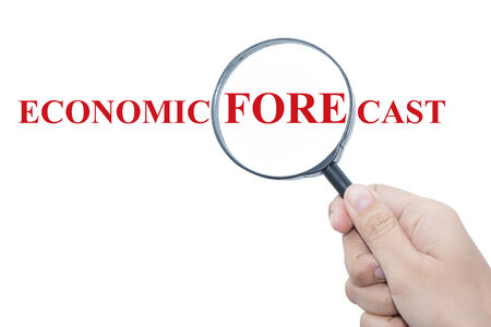economic forecast: Hand Showing ECONOMIC FORECAST Word Through Magnifying Glass