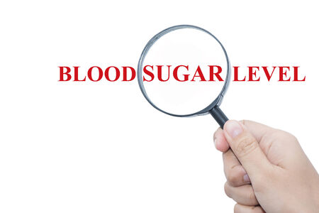 type 1 diabetes: Hand Showing BLOOD SUGAR LEVEL Word Through Magnifying Glass Stock Photo