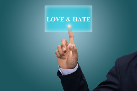 enmity: Businessman hand pointing LOVE & HATE Stock Photo