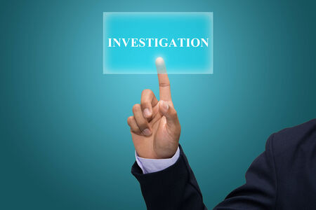 Businessman hand pointing INVESTIGATION Stock Photo