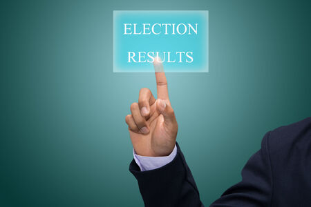 local council election: Businessman hand pointing ELECTION RESULTS