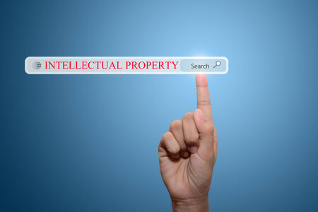 Businessman hand pointing INTELLECTUAL PROPERTYct