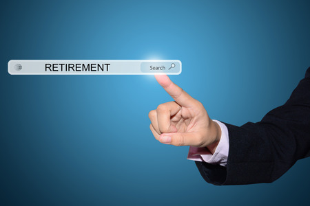 resign: Businessman hand pointing RETIREMENT