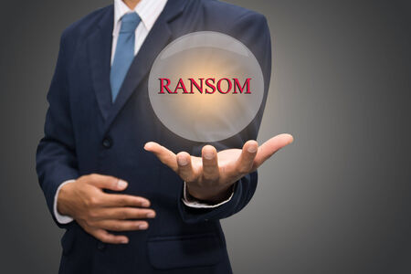 ransom: business man hand writing RANSOM Stock Photo