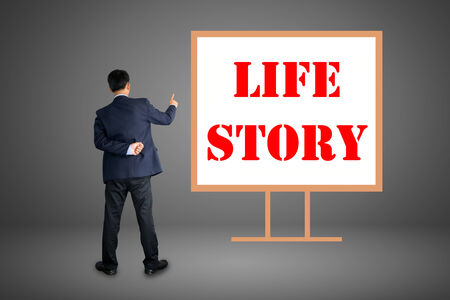 Business hand writing LIFE STORY photo