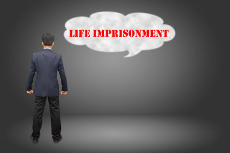 imprisonment: Business hand writing LIFE IMPRISONMENT