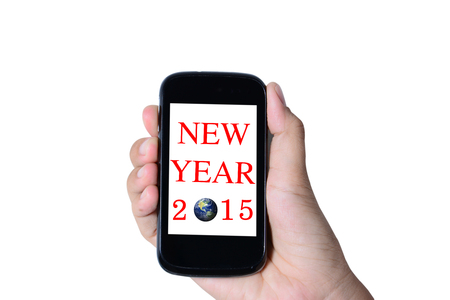 Modern mobile phone in a hand isolated, Business Concept 2015 photo