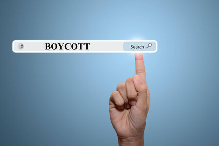 boycott: Business and technology, searching system and internet concept - male hand pressing Search BOYCOTT button.