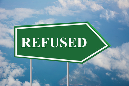 disallow: Write a REFUSED on the Road Sign Stock Photo