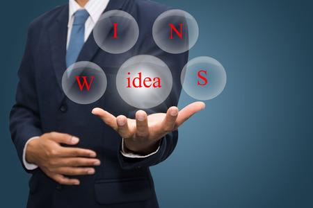 wins: businessman hand write a idea wins Stock Photo