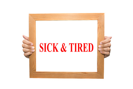 Businessman hand holding SICK & TIRED