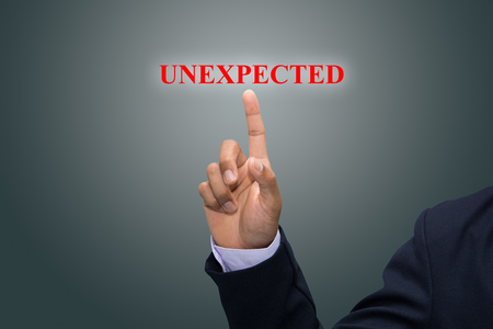 unanticipated: Businessman hand pointing UNEXPECTED Stock Photo