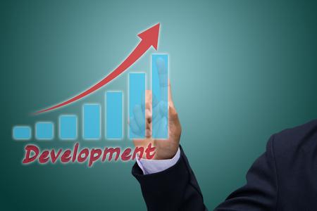 Businessman Hand Showing Development graph