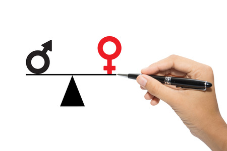 Depicted in a conceptual image by a man drawing a seesaw showing the male and female genetic symbols in equilibrium. Equality between the sexes.