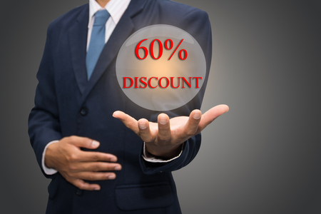 advertised: Businessman hand write a 60% DISCOUNT