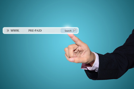 prepaid: Business man hand pointing PRE-PAID