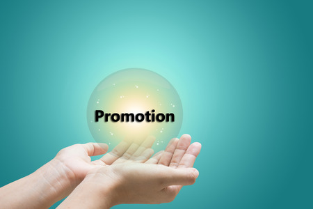 businessman hand write a Promotion