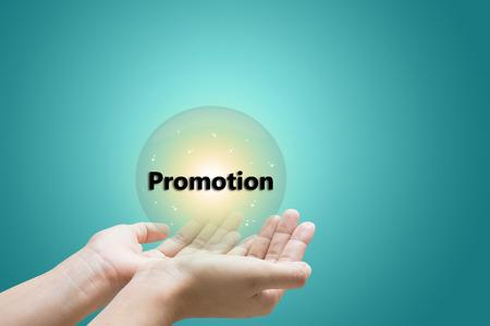 businessman hand write a Promotion